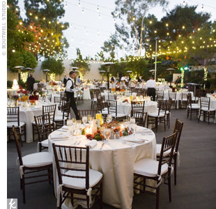 The couple knew they wanted both their ceremony and reception to take place outside. Colorful centerpieces stood out against white linens and worked with the natural scenery.