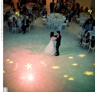 Blue and yellow lighting made the dance floor look like a starry night sky. The couple also projected their initials onto the ground.