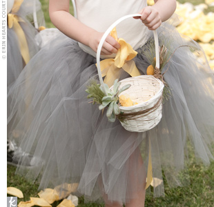 Chris' niece and cousin wore custom-designed tutus with gray tulle and yellow sashes, with white leotards underneath. Their white baskets were decorated with succulents.