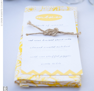 "Chris used twine to tie ""love knots"" around the menu cards and yellow-and-white patterned napkins."