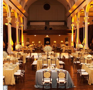 A modern damask pattern on light yellow linens covered the reception tables, and the venue's all-white dance floor matched the color palette.