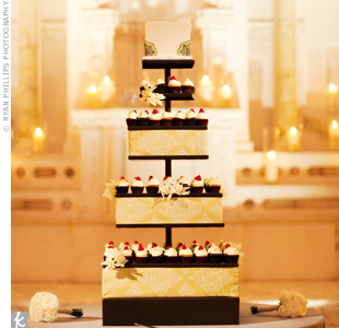 Since there would be many other desserts floating around, the couple opted for a cupcake tower. Fabric matching the table linens covered the tiers and orchids added a soft touch.