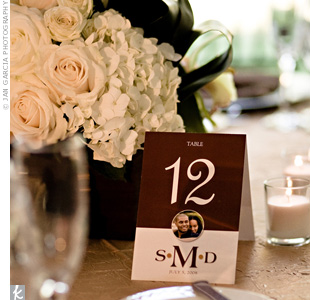 In keeping with the color palette, the table numbers were brown and white. They also each had the couple's monogram and a small photo of them.