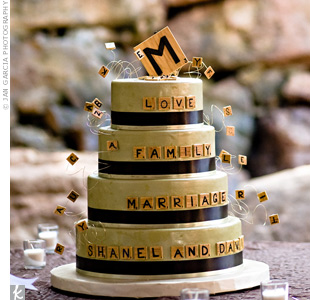 As a nod to David's proposal, the four-tiered wedding cake was Scrabble-themed. The baker used fondant to make Scrabble tiles that spelled out words on the tiers.