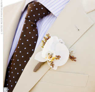 Barry wore a white phalaenopsis orchid decorated with ribbon and a single seashell to coordinate with Rachel's bouquet.