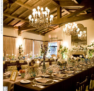 Guests sat at two long, rectangular tables covered with chocolate-brown linens and champagne runners. Candles of varying heights and shapes were scattered across the tables.