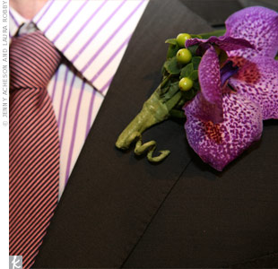 To match Alex, Corey wore vanda orchids on his lapel. The purple flowers coordinated with his purple, striped shirt.