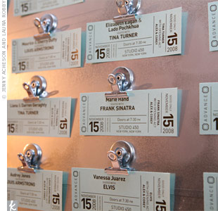 To honor Corey's music-industry job, the couple named their tables after some of their favorite musicians. The escort cards were printed to look like concert tickets.