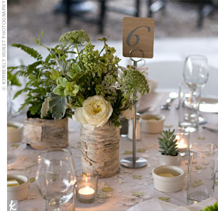 The couple made birch-bark vessels for their earthy centerpieces, which included roses, lilacs, Queen Anne's lace, nerine lilies, succulents, anemones, and dill.
