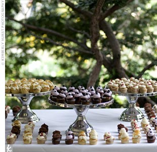 To fit their laid-back atmosphere, the couple went with mini cupcakes instead of cake for dessert. Cake stands upped the elegance of the display.