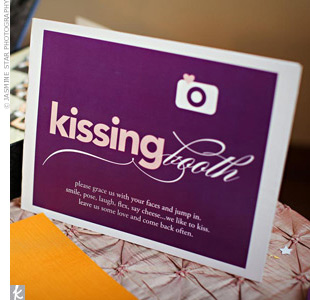 "In lieu of a traditional guest book, Alicia and Steven set up a ""kissing booth"" where guests could leave behind a lip print with their signature."