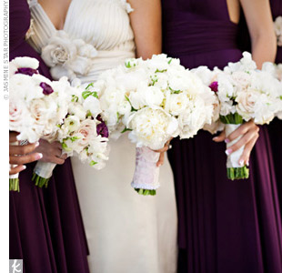Peonies, roses, and sweet peas echoed the wedding gown's scalloped edges.