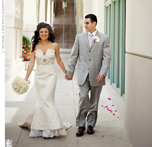 Alicia's lace-trimmed gown and Steven's light-gray suit fit the vintage, semiformal setting.