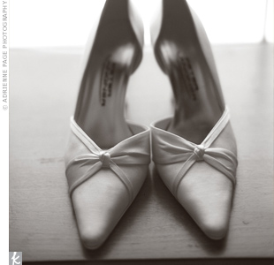 The folds in the bride's shoes echoed the design of her gown's neckline.