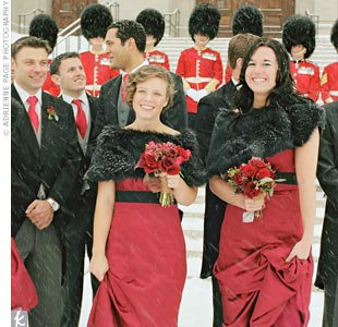 To stay warm on the winter day, the bridesmaids wore black faux fur wraps over their claret-colored gowns