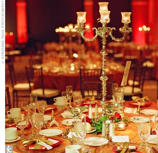 Candelabras were a romantic alternative to floral arrangements. Magnolia leaves, roses, and hypericum berries added a holiday feel.