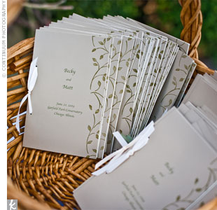 Olive green leaves stamped onto the covers of Rebecca and Matthew's ceremony programs complemented a quote on the back page from The Giving Tree, a book the couple loves.