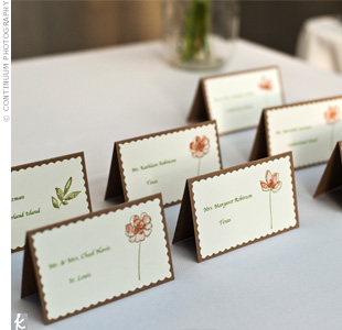 Matt's crafty mom Linda printed guests' names in olive green on ivory paper and stamped coral or green flowers next to the names. Then she pasted the paper onto tented cards.