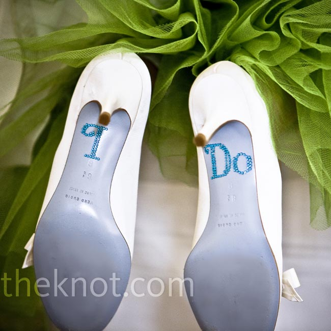 "Amy incorporated ""something blue"" into her wedding shoes, with powder blue soles and a darker blue ""I do"" design."