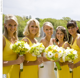 The five bridesmaids wore cheery yellow silk dresses accented with bouquets of white daisies, green button mums, yellow snapdragons, and green hydrangeas.