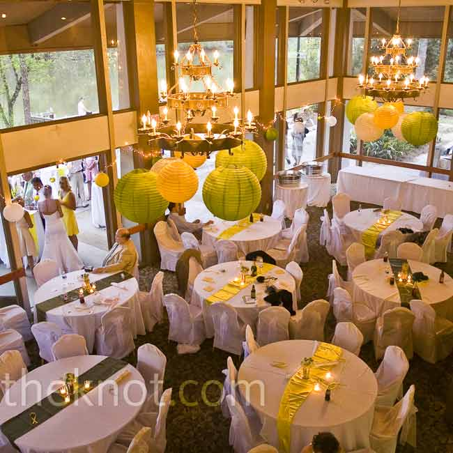 The reception tables got a burst of color from bright yellow or green table runners. Yellow, green, and white paper lanterns hung from the chandeliers overhead.