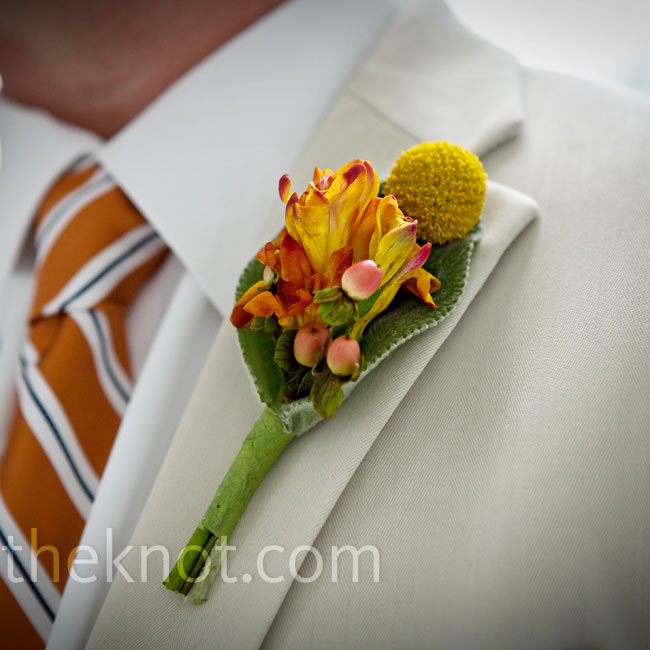 Brett wore a scaled-down version of Cori's bouquet on his lapel. Orange freesia, yellow craspedia, lamb's ear, and liriope made up his earthy boutonniere.
