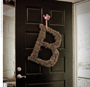"The bride's favorite detail of the ceremony décor was a large letter ""B"" wreath covered in moss, which hung from the front door of the Brumby House."