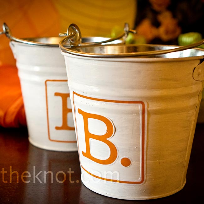 "The couple's nieces carried little tin buckets that featured the couple's ""B"" logo."