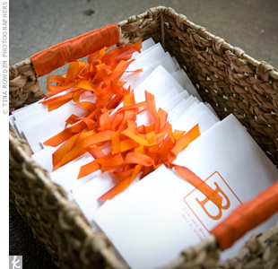 The bride made the programs herself by printing their initial logo on white card stock and tying them together with a simple orange ribbon.