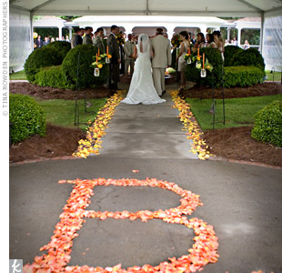 Orange flower petals in the aisle formed the first letter of the couple's last name as they walked toward the ceremony spot.