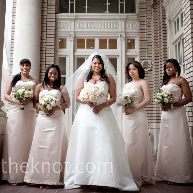All four bridesmaids wore elegant ruched A-line dresses in a soft champagne color. They individualized their looks with their own accessories.