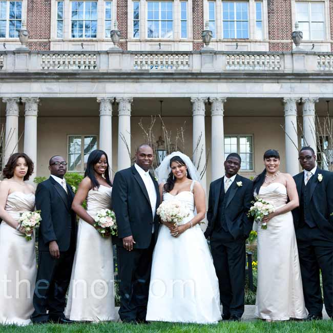 The men wore classic black tuxedos with ties that matched the couple's color scheme. Dele wore a white-on-white vest and tie combo to stand out from his groomsmen.