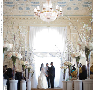 The couple used The Biltmores grand space for both their ceremony and reception. Neither Jessica nor Dele is Jewish, but they love the significance of the huppah, and how it represents the couples new home together.
