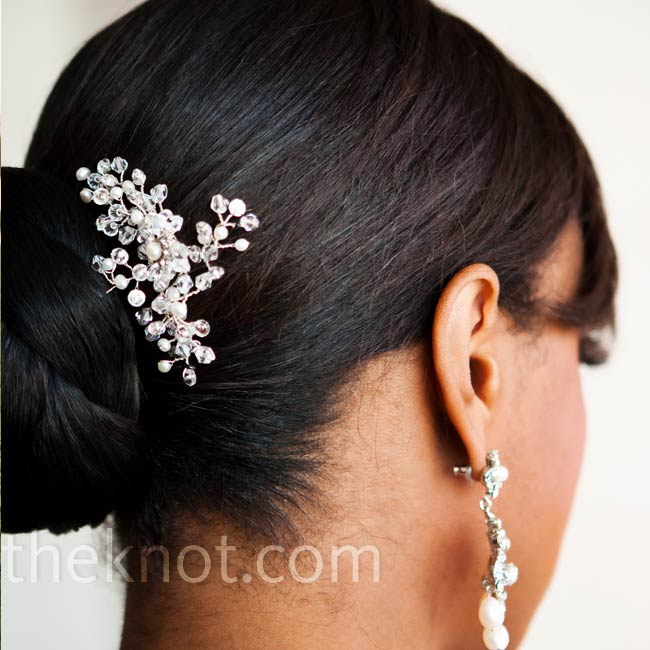 Kimberly found a Malis Henderson hair comb that perfectly matched the detailing of her dress without taking away from her dangly earrings.