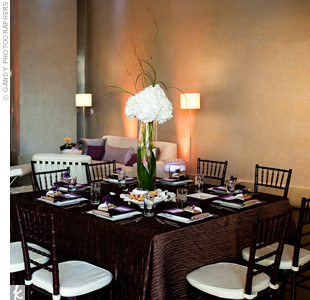 For an earthy edge, the contemporary square dinnerware was presented on brown Cortina linens. Scattered rose petals and candlelight added a soft touch.