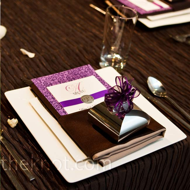 A personalized cover sheet fixed to aubergine- and lavender-print card stock made up the DIY menus. Lavender ribbon and a silver seals were an elegant touch.