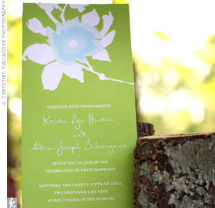 The elegant floral motif on the couples invitations reflected their blue-and-green color scheme, as well as their nature-inspired style.