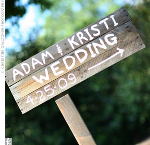 A simple, hand-painted sign directed guests to the couples outdoor celebration.