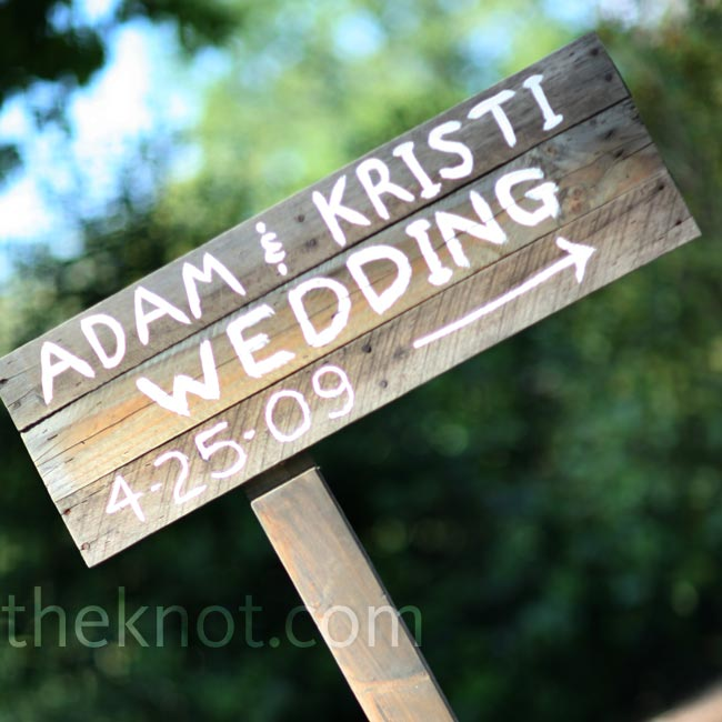 A simple, hand-painted sign directed guests to the couple's outdoor celebration.