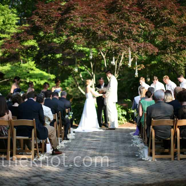 A sweet little garden area beneath a Japanese maple tree served as Kristi's and Adam's ceremony spot. Soft pools of rose petals lined the aisle.