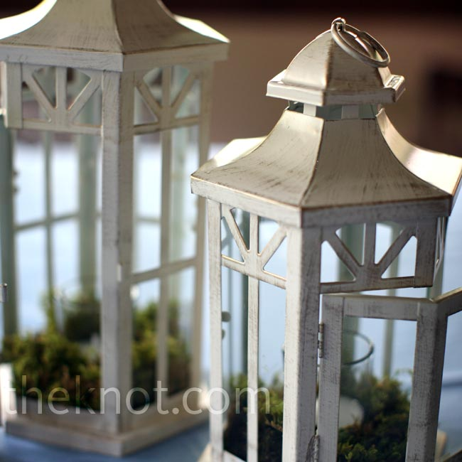 Antique lanterns, lit with flickering votive candles gave the reception tables a rustic look.