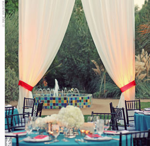 "Create outdoor ""rooms"" -- such as the buffet, lounge, or dance floor -- by hanging  curtains to block off certain areas of your reception space."