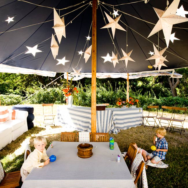 "Alison believes in catering to her crowd! Keep kids occupied (and give their parents a break!) by creating a ""kids tent"" with crafts, games, and –- most importantly –- a babysitter. Hanging 3-D stars give the room a kid-friendly atmosphere."