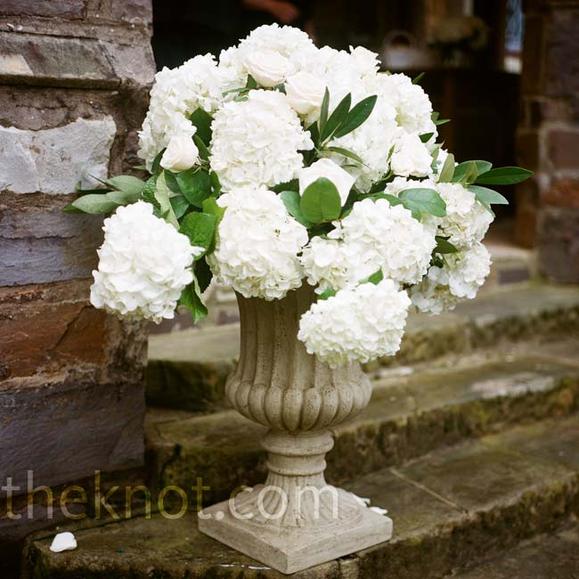 Large urns filled with white hydrangeas and roses were placed along the steps leading up to the chapel entrance.