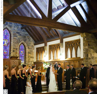 Frost Chapel's heavy wood-beamed ceiling, flagstone floor and stained-glass windows provided a stunning backdrop to the ceremony.