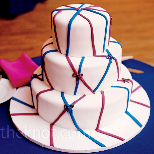 To tie in the colors, the cake was decorated with raspberry and navy fondant.