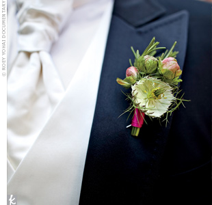 Pink satin ribbon and pink rosebuds tied in the guys boutonnieres with the overall color theme.