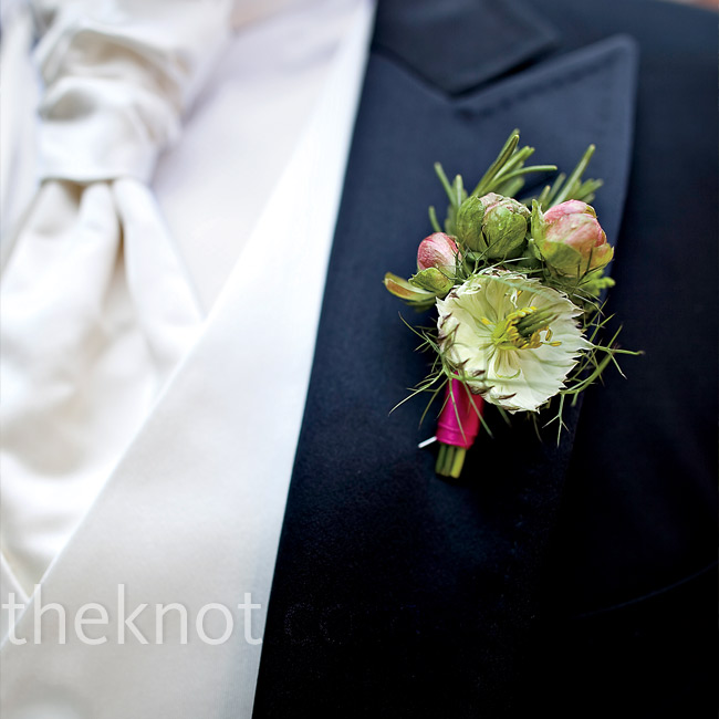 Pink satin ribbon and pink rosebuds tied in the guys' boutonnieres with the overall color theme.