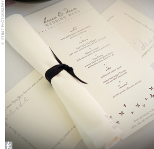 A purple butterfly design and a mix of classic and contemporary fonts helped push the wedding's whimsical-elegance theme.