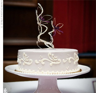 A simple strawberry cream cake was part of the dessert buffet. The couple's friend created the butterfly-inspired cake topper.